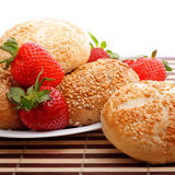 Buns and strawberry Stock Photos