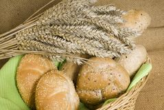 Buns and wheat. In the breadbasket Stock Photography
