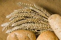 Buns and wheat Stock Photos