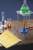 Bunsen burner tripod flask and test tubes in science laboratory Royalty Free Stock Images
