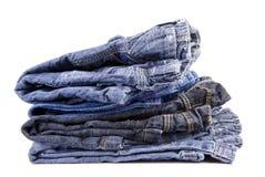Bunt av barns jeans som isoleras på vit Royaltyfri Fotografi