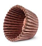 Bunt av bruna pappers- koppar för stekheta muffin på sidan Arkivbilder