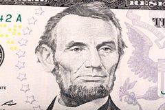 Bunt av fem U S dollar Närbildstående av Abraham Lincoln Royaltyfri Fotografi