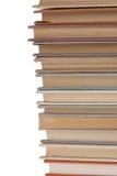 Bunt av gamla böcker på vit Arkivfoton