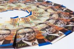 Bunt av israeliska pengarräkningar av sikel 100 Arkivbild