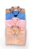 Bunt av kulöra mäns skjortor Fotografering för Bildbyråer