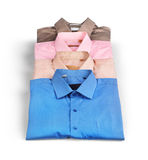 Bunt av kulöra mäns skjortor Arkivbild