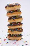 Bunt av nya bakade donuts Arkivbild