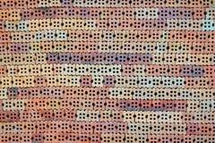 Bunt av orange tegelstenar i konstruktionsplats med bakgrund för textur för tegelstenvägg, byggnadsmaterial arkivfoton