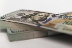 Bunt av pengar i US dollarkassasedlar Arkivbilder