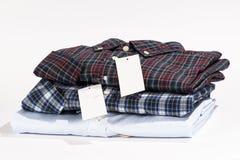 Bunt av vikta skjortor Royaltyfri Bild