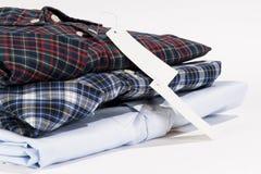 Bunt av vikta skjortor Royaltyfri Foto