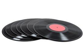 Bunt av vinylrekord på vit bakgrund Arkivfoton