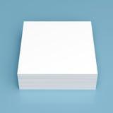 Bunt av vitbok på blå bakgrund royaltyfri bild