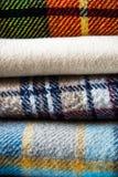 Bunt av woolen kontrollerade filtar Royaltyfri Fotografi