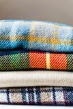 Bunt av woolen kontrollerade filtar Royaltyfria Foton