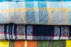 Bunt av woolen kontrollerade filtar Fotografering för Bildbyråer