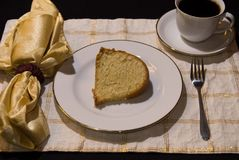 Bunt cake 5. Fresh home baked vanilla bunt cake displayed on china setting Royalty Free Stock Photo
