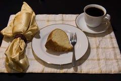 Bunt cake 6. Fresh home baked vanilla bunt cake displayed on china setting Stock Image
