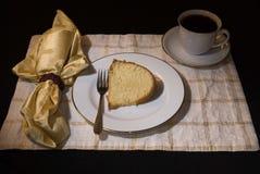 Bunt cake 7. Fresh home baked vanilla bunt cake displayed on china setting Stock Photos