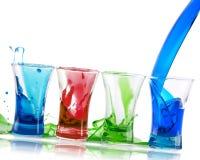 Bunt för alkoholistskottcoctailar med färgstänk Royaltyfria Bilder