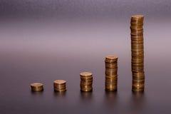Bunt för guld- mynt royaltyfria bilder