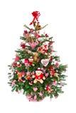 Bunt verzierter lokalisierter Weihnachtsbaum mit roter Dekoration Lizenzfreie Stockbilder