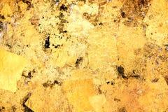 Bunt vom Goldblatt-Wandhintergrund Lizenzfreies Stockbild