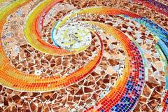 Bunt vom Mosaikhintergrundboden Stockfotos