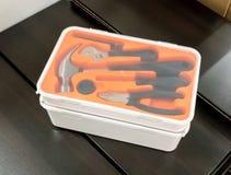 Buntar av det genomskinliga plast- toolboxfallet Royaltyfri Bild
