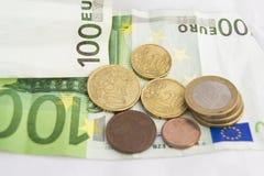 Buntar av euromynt och sedlar Royaltyfri Fotografi