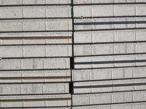 Buntar av grå färgmurbrukstenar arkivbilder