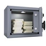 Buntar av kontant in ett öppet metallkassaskåp Arkivbild