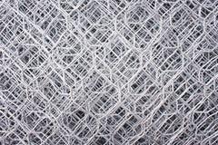 Buntar av netto modeller för stål texturerar bakgrund för byggandestaket arkivfoto