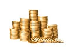 Buntar av skinande mynt arkivfoto