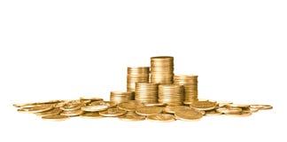 Buntar av skinande mynt fotografering för bildbyråer