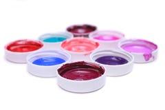 Bunte Acrylfarben in den Abdeckungen Stockbild