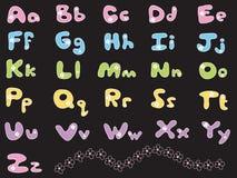 Bunte Alphabete des Gänseblümchens Stockfotos