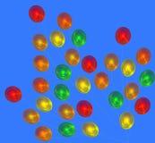Bunte Ballone auf einem blauen Hintergrund Stockfoto