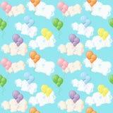 Bunte Ballone und Wolken auf blauem Himmel Stockfotos
