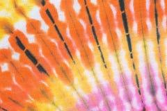 Bunte Bindung färbte Muster auf Baumwollgewebehintergrund lizenzfreies stockbild