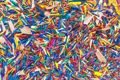 Bunte Bleistiftschnitzel für Hintergrund Lizenzfreie Stockfotos
