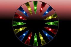Bunte Blinklichter auf Farbhintergrund mit Kopienraum Stockbilder