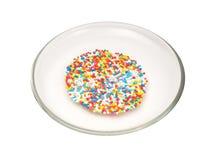 Bunte Bonbons auf Platte Stockfotografie