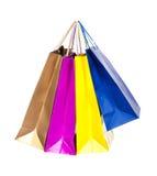 Bunte Einkaufenbeutel in der Reihe Lizenzfreies Stockbild