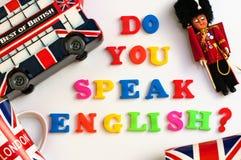 Bunte englische Wörter SPRECHEN SIE ENGLISCH mit Andenken von London, englische Sprachlernkonzept stockbild