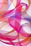 Bunte Farbbänder auf Weiß Lizenzfreie Stockbilder