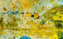 Bunte Farbentropfen auf dem Boden Stockfoto
