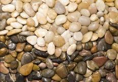 Bunte Felsen in der Wellenauslegung. Stockfotografie