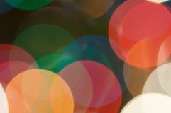 Bunte festliche mehrfarbige Kreise Defocused abstraktes mehrfarbiges bokeh beleuchtet Hintergrund lizenzfreie stockbilder